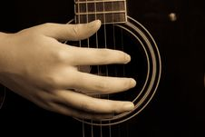 Hand And Guitar Stock Photo
