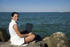 Free Woman With Laptop On The Beach Stock Photography - 6322552