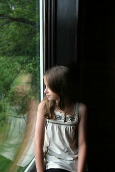 Free Pretty Girl Looking Out The Window Stock Photos - 6324273