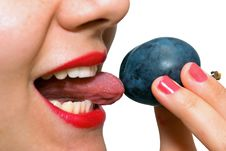 Free Girl Eating A Plum, Licking It Royalty Free Stock Photo - 6324355