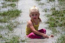 Free Girl In Muddy Water Royalty Free Stock Photos - 6324478