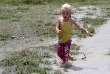 Free Girl In Muddy Water Royalty Free Stock Images - 6324479