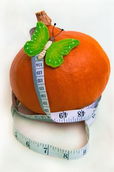 Butterfly On A Pumpkin And A Measuring Tape Royalty Free Stock Photos