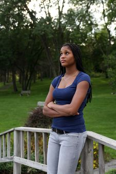 Free Pretty Black Teenage Girl Standing In A Park Stock Photo - 6325490