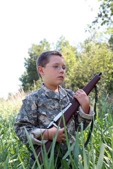 Free Young Boy Holding Toy Rifle Stock Photos - 6325543