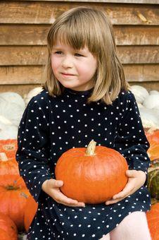 Free Cute Little Girl Holding The Pumpkin Stock Photos - 6325893