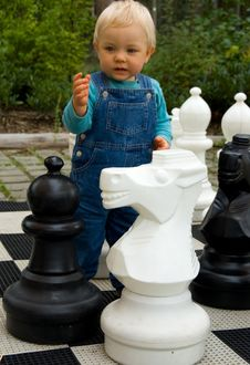 Free Boy Enjoying Lifesize Chess Game Stock Photography - 6326162