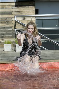 Woman Splashing Water On Pool Stock Image