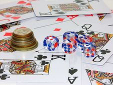 Coins, Playing Bones And Playing Cards Stock Photo
