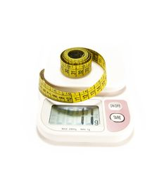 Free Whirled Yellow Tape Measure And A Scale Stock Photos - 6326893
