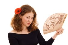 Free Young Woman Holding A Fan Stock Image - 6326991