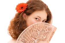 Free Young Woman Face Behind A Fan Stock Photography - 6326992