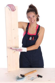 Free Woman Carpenter Holding Wooden Plank Royalty Free Stock Image - 6328026