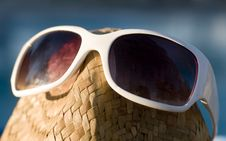 Free A Straw Hat With Sun Glasses Sitting Beside Pool Royalty Free Stock Images - 6329259