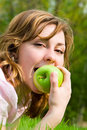 Free Pretty Woman Eating Green Apple Stock Image - 6338891