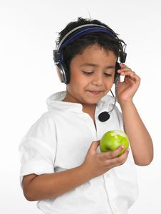Free Boy Biting Into A Green Apple Royalty Free Stock Photography - 6330067