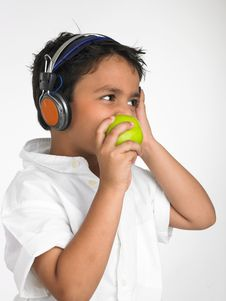 Free Boy Biting Into A Green Apple Stock Photography - 6330072