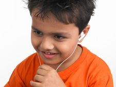 Free Asian Boy Listening To Music Stock Image - 6330601