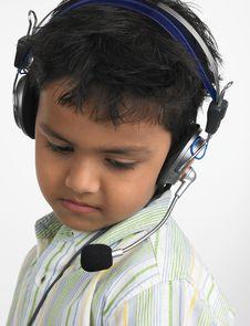 Free Indian Boy Wearing Head Phone Stock Image - 6331591