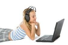 Teen Girl On Laptop With Earphones Royalty Free Stock Photo