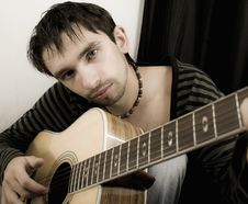Free Young Man With A Guitar Royalty Free Stock Photo - 6335305