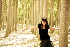 Young Playful Woman In The Woods Royalty Free Stock Photo