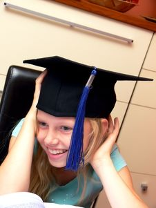 Smiling Girl In Graduation Cap Stock Photo