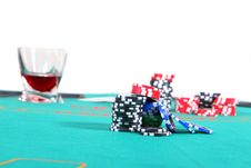 Poker Table With Liquor And Chips Royalty Free Stock Photography