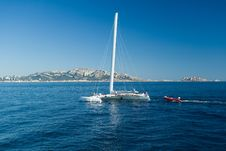 Free Catamaran On Blue Sky And Sea Royalty Free Stock Photo - 6338735