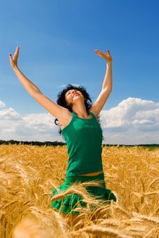 Free Woman Jumping In Golden Wheat Royalty Free Stock Photo - 6339145