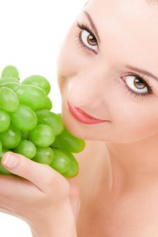 Pretty Woman With Green Grape Stock Photography