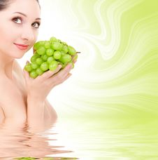 Pretty Woman With Green Grape Royalty Free Stock Image