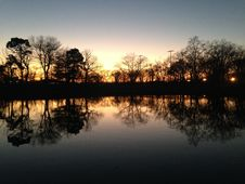 Trees Reflecting In Water Surface During Sunset In Winter. Royalty Free Stock Image