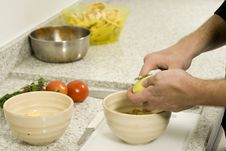 Free Hands Peeling Potatoes Stock Photos - 6340863