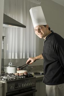 Chef Grilling Steaks Royalty Free Stock Image