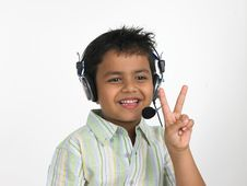 Free Boy With Headphones Victory Sign Royalty Free Stock Photography - 6341167