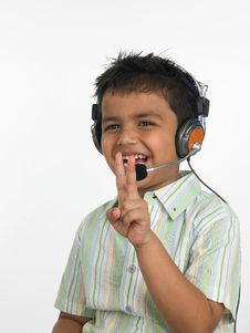Free Boy Showing Victory Sign Royalty Free Stock Image - 6341176