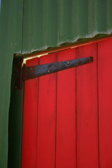 Red Door, Green Frams Stock Photo
