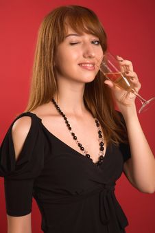 Winking Girl With Champagne Glass Royalty Free Stock Photo