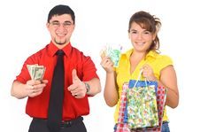 Young Man And Woman Holding Money Stock Photos