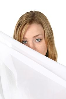 Free Woman Looking Over White Pillow Stock Photos - 6345273