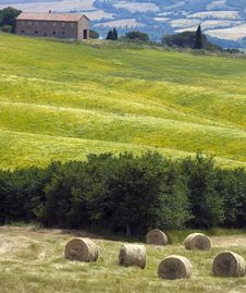 Tuscany Countryside With Farm And Hayball Royalty Free Stock Photo