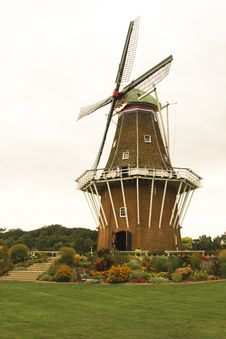 Dutch Windmill And Display Of Tulips Stock Images