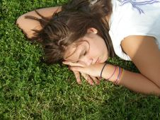 Free Girl Sleeping In The Grass Stock Photography - 6359762