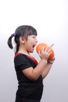 Free Girl Eat Pumpkin Royalty Free Stock Image - 6361656