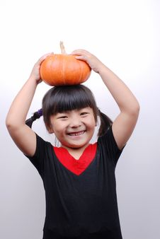 Free Girl And Pumpkin Royalty Free Stock Photo - 6361695