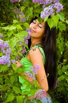 Free The  Girl And Blossoming Lilac Royalty Free Stock Image - 6361816