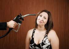 Free Woman With Gas Nozzle To Her Head Royalty Free Stock Photo - 6363695