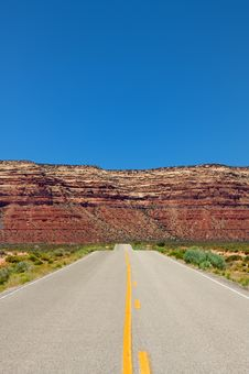 Desert Highway Leading Into Mountains Stock Image