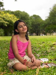 Asian Girl Sitting In A Park Stock Images